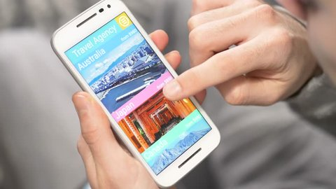 Online travel agency showing their offers on a smartphone device. User browsing the content.
