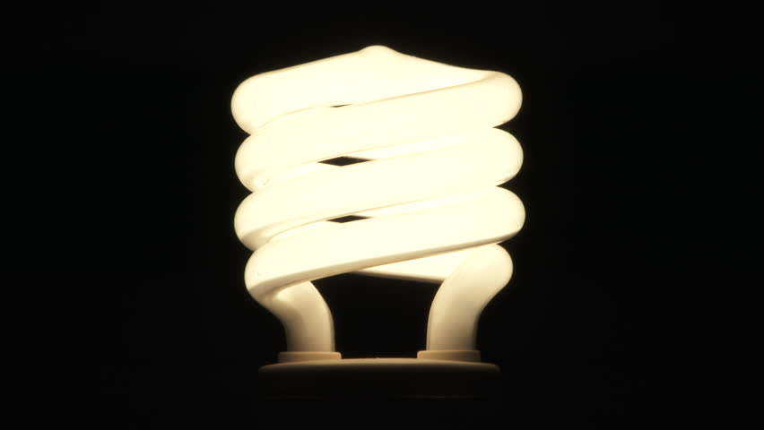 4k00 21close Up On Centered Compact Fluorescent Lamp Light Bulb Turning Flickering And Off Seamless Looping Against Black Background