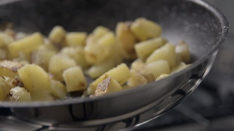 Potatoes and meat cooking slowmotion
