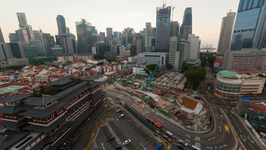 Time lapse movie of Singapore Chinatown cityscape along with construction sites and auto traffic early morning wide angle view 4k UHD