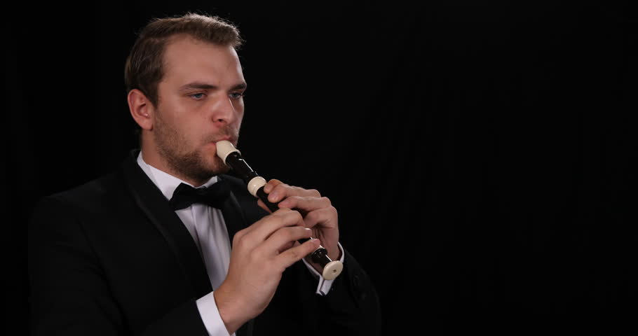 Young Instrumentalist Man Sing Flutist Singer Play Recorder Performing Symphony | Shutterstock HD Video #1008444544
