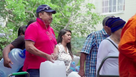 Cape Town, South Africa - 25 February 2018 : Residents of Cape Town, South Africa are forced to queue for water around the city, as a crippling drought threatens the city's water supply.