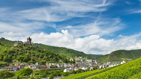 Summer vineyards timelapse at Moselle Valley with Cochem, Eifel in Germany in the background and the Reichsburg Cochem to the left.