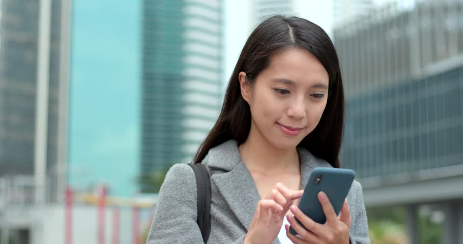 Business woman use of smart phone in city  | Shutterstock HD Video #1008545704