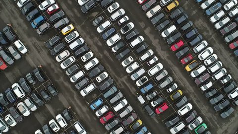 GERMANY - SEPTEMBER 2017: Overhead drone shot of organized parking lot for second hand (used) cars at a large car dealing company in Germany