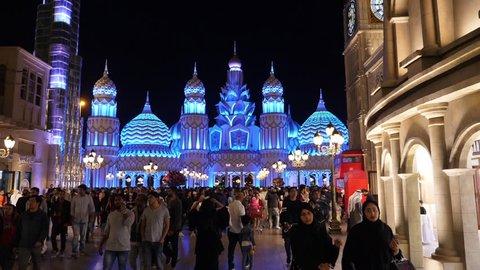 Dubai, UAE - January 12, 2018: bright evening illumination on artistic installation Asian Kremlin in Global Village in Dubai city. Decorative building on alley Asian Kremlin amusement park Dubai city.