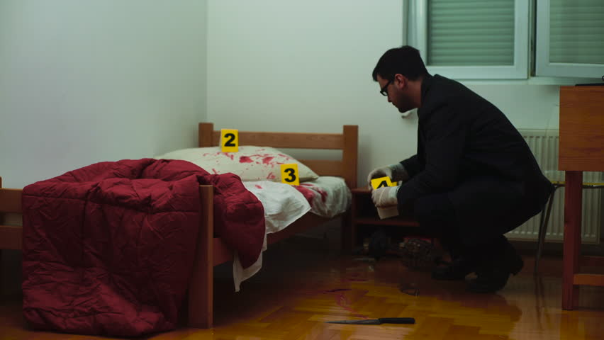 Police detective, forensic expert in gloves using evidence markers to marking knife and the other bloody traces of murder on bed and floor at room, concept crime scene, csi, homicide, room interior.