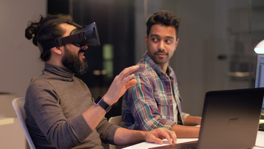 deadline, augmented reality and technology concept - creative man with virtual headset or 3d glasses at night office