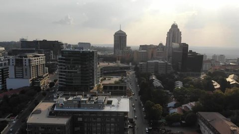 Sandton, Johannesburg / South Africa - March 2 2018: Flying over downtown Sandton, the economic hub of Johannesburg, late on an autumn afternoon