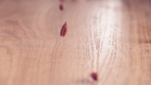 Bunch of Goji-Berries authentic Slow-Motion falling on wooden table, close up