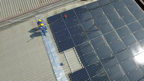 aerial view of cleaning solar panels on the roof