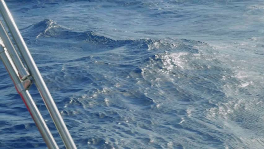Slow motion view of ocean water over board of yacht | Shutterstock HD Video #1008598324