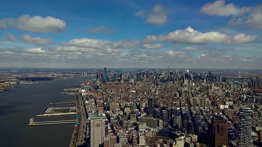 Manhattan densely populated borough New York City economic administrative  historical birthplace clouds, Hudson, East River boat carry passengers cargo Stock Video Footage time-lapse cargoes USA    Shutterstock HD Video #1008634624