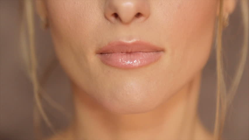 Women's lips, painted with light pomade
