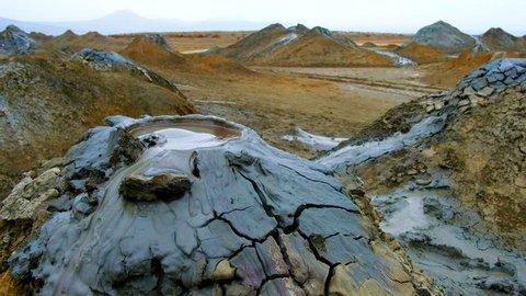 Boiling muddy bubbles in crater of mud volcano of Gobustan near Baku, Azerbaijan, v07