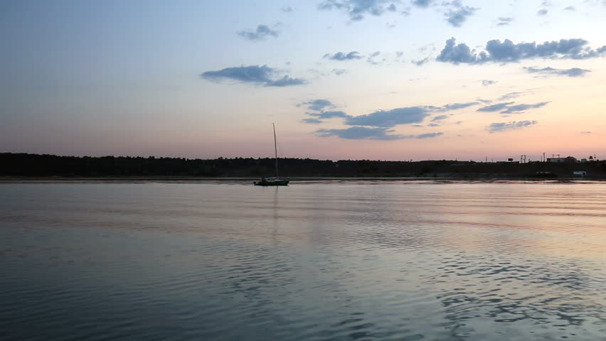 Sunset on the river. Video shooting from the boat. Colorful evening sky over river.   Shutterstock HD Video #1008721994