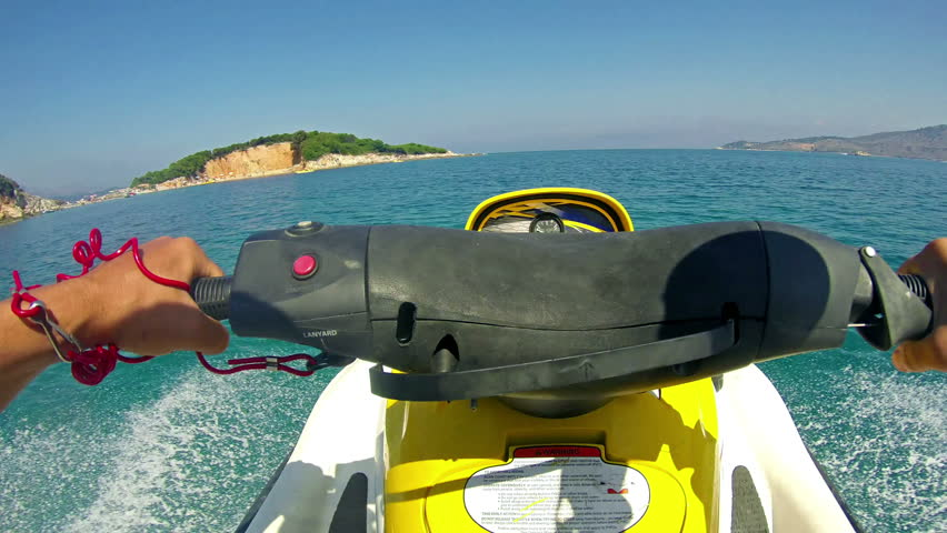 Jetski sport race pov. Tourism and recreation is main source of income to Corfu island. Beautiful clear green water.