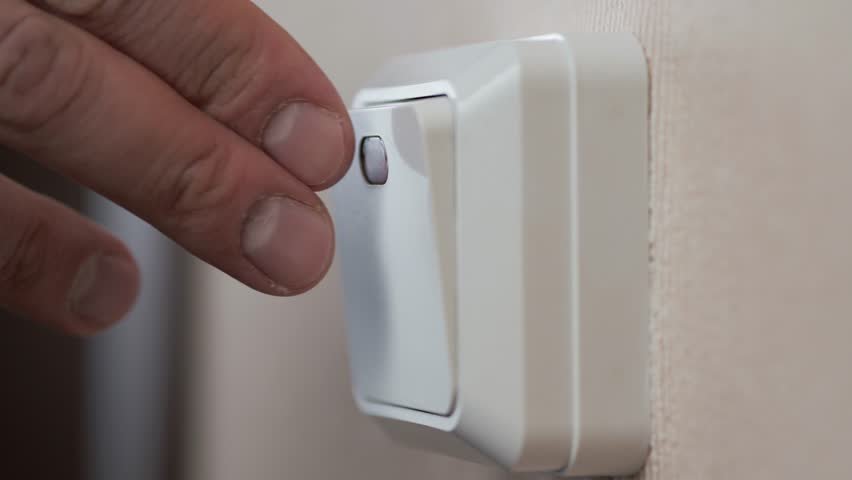Close up of finger is turning on or off on light switch. Macro super   Shutterstock HD Video #1008728354