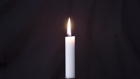 Timelapse of long isolated candle burning with dark background. Eventually burns out - after an actual 7 hours.