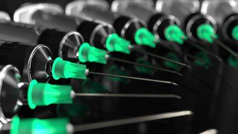 CIrcle of syringes with needles against black background, macro loopable animation