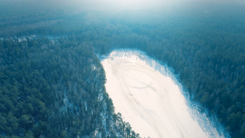 Frozen Lake in The Middle of Woods, Aerial View  | Shutterstock HD Video #1008760844
