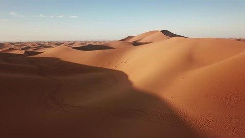Aerial view on sand dunes in Sahara desert at sunrise, Africa, 4k