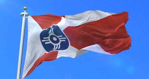 Wichita city flag, city of USA or United States of America, waving at wind in blue sky, slow - loop