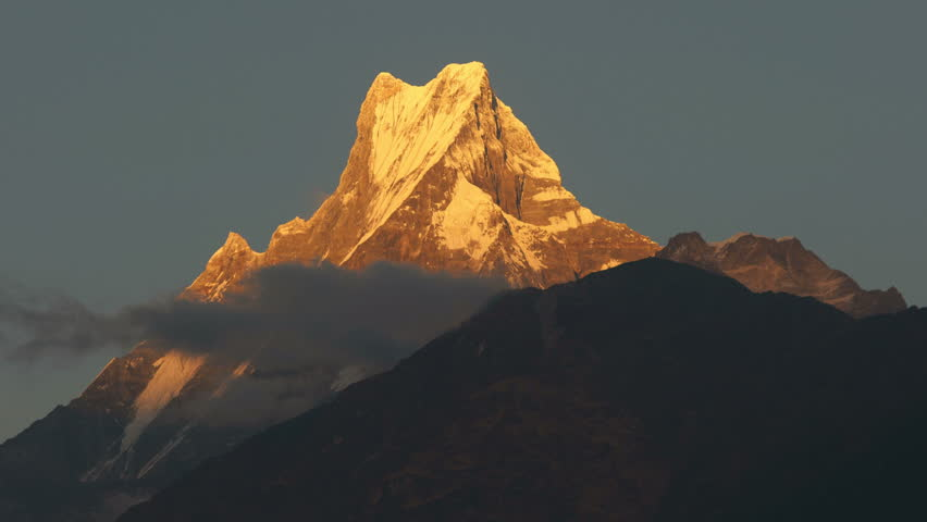 Annapurna base camp trek, View on the summit of the mountain Machapuchare at sunset, Nepal, asia.