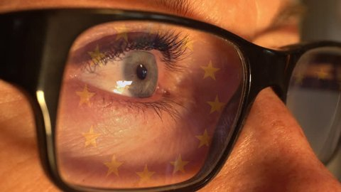 "The new EU-regulation ""General Data Protection Regulation"" (Gdpr) takes effect in May 2018. Info. on a screen reflected in a womans glasses"