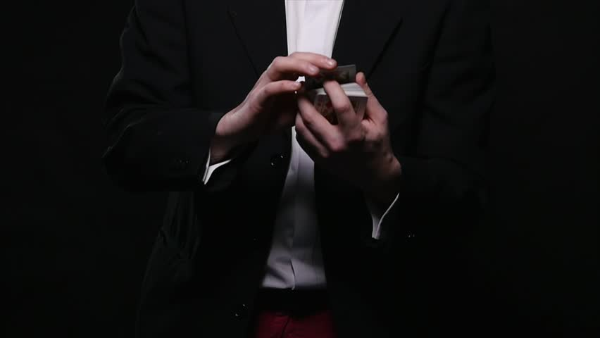 Magic, card tricks, gambling, casino, poker concept - man showing trick with playing cards | Shutterstock HD Video #1008822344