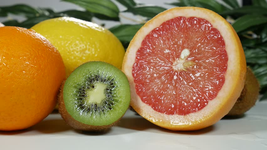 Beautiful, juicy and fresh fruit on the table for presentation. Oranges, greyfruits, lemons, kiwi. | Shutterstock HD Video #1008835544