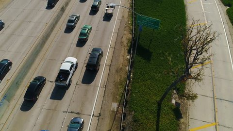 Heavy freeway traffic in los angeles  tilt up to city  camera moves into  city