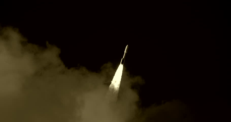 Space Rocket or ICBM missile emerging from behind clouds and flying through black sky with bright flames and a nice trail of white exhaust smoke. 4K at 120 fps slow motion.