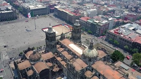 Mexico City - aerial view, the zocalo in mexico city, with the cathedral and giant flag in the centre, Mexican Flag waving high over Mexico, Constitution Plaza