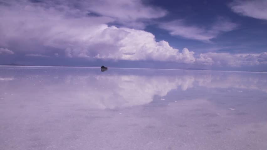 a Jeep crossing the Salt Flats of Uyuni Salar in Bolivia