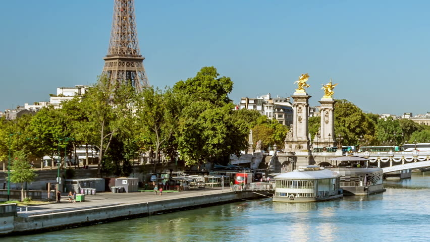The Pont Alexandre III arch bridge and the Eiffel tower, two famous landmarks of Paris.  | Shutterstock HD Video #1008893624