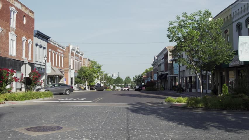 Small town streets on a sunny day | Shutterstock HD Video #1008919334