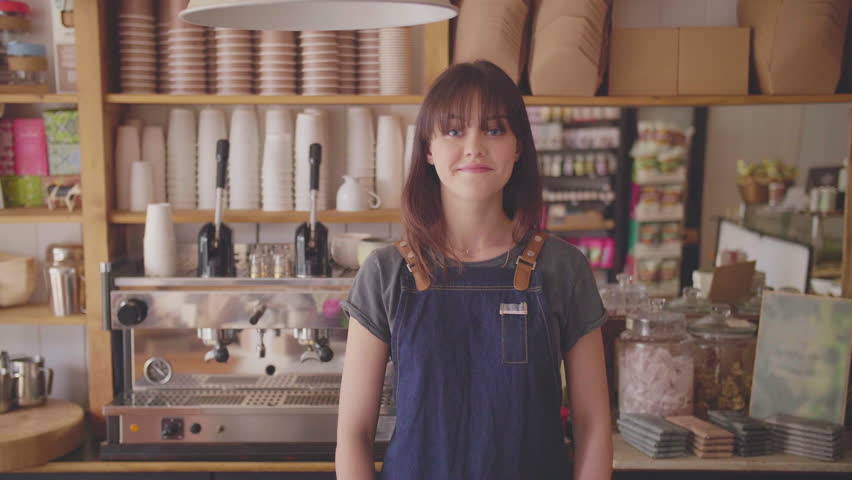 Smiling Small Business Owner Standing Arms Crossed In Coffee Store