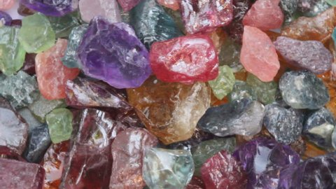 Colorful uncut gemstone,ruby,zircon,amethyst,citrine,pink sapphire,green sapphire,garnet,blue,peridot,emerald,motion background