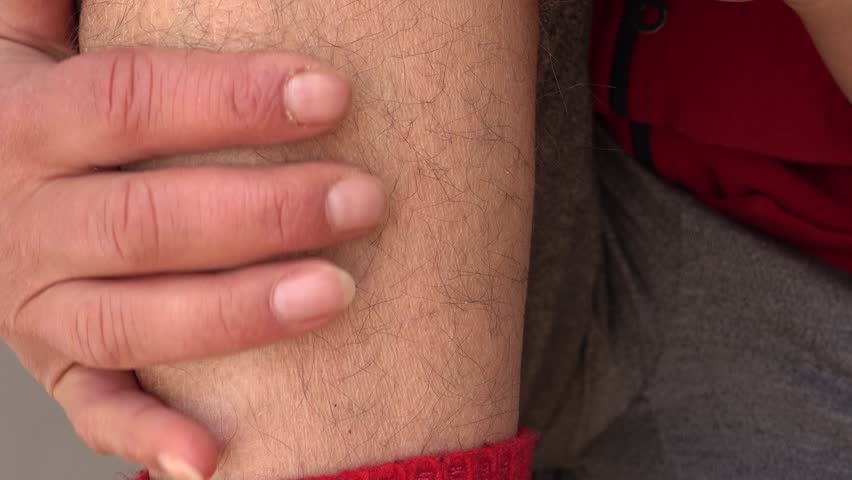 4K Lifting pant leg and revealing hairy ankle, extreme close up  | Shutterstock HD Video #1008953444