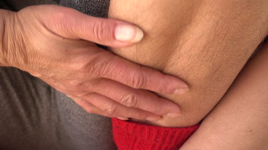 4K Close up hairy ankle of female  | Shutterstock HD Video #1008997274