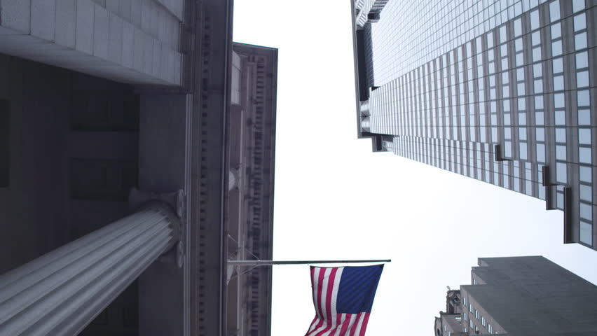 Symbols of the United States of America. State flag, the banking system. Financial district of New York City. Dolly shot .