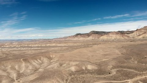 Aerial footage filmed by a drone flying over the high desert landscape of Western Colorado. Filmed near Grand Junction, CO.