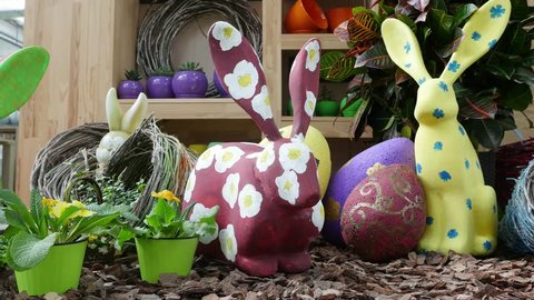 the festive exhibition of decorative rabbits for the Easter holidays. toy animals in flowers. hares with polystyrene. Painted figures.