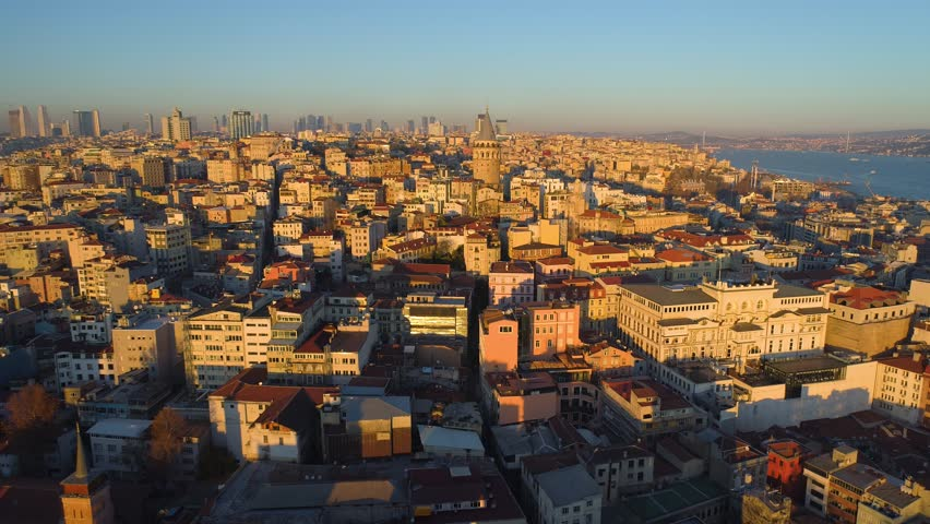 Galata tower in Istanbul, Turkie. Aerial drone shot from above, city centre, downtown. European part of the city. Sunny day, sunset. | Shutterstock HD Video #1009113524
