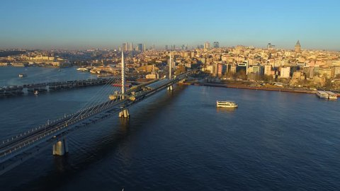 Aerial drone view of the Istanbul, Turkie. Bosphorus Halic bay. Sunny day. Fly over the bridges: Golden Horn Metro Bridge, Galata bridge. European part of the city, downtown.