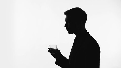 Young man silhouette drinking mineral water, pH balance in healthy body, diet
