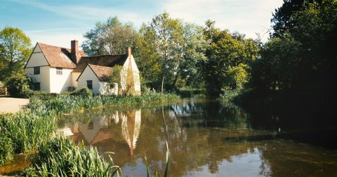 The modern Hay Wain scene. A contemporary view of the scene made familiar by the English Landscape painter, John Constable, with his painting 'The Hay Wain' located at Flatford, Dedham Vale, Suffolk.