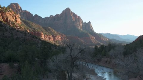 Clip at sunset of the Watchman rock formation in Zion National Park, Utah with the Virgin River in foreground flowing.