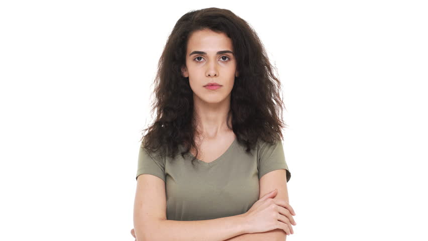 Portrait of concentrated brunette woman touching chin thinking about important things and doubting or trying to calculate best option, over white background. Concept of emotions